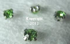 15 Glas Aufnähsteine Silber Fassung ca. 4,5mm Peridot